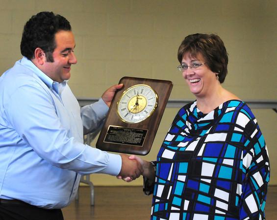 West Newbury: West Newbury lead public safety dispatcher Lee Ann Delp is awarded the Jeff Grossman 911 award by the namesake's son, Daniel in a ceremony on Thursday. Bryan Eaton/Staff Photo