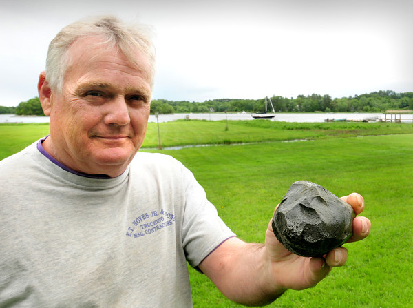 Amesbury: Phil Green found this what appears to be a rock near the sailboat in back at low tide in the Merrimac River behind his home some years back. His sister-in-law sent it to NASA where it was determined to be a piece of the Russian space station Mir. Bryan Eaton/Staff Photo