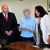Newburyport: Newburyport Mayor Donna Holaday presents Charlotte McLaughlin with a proclamation honoring her 60th year as a poll worker and warden in the city. Also reading proclamations from the statehouse were state Rep. Mike Costello, left, and state Sen. Kathleen O'Connor Ives, out of view. Bryan Eaton/Staff Photo