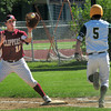 North Reading: Newburyport first baseman Travis Wile has the throw forcing out North Reading's Ryley Warnock. Bryan Eaton/Staff Photo