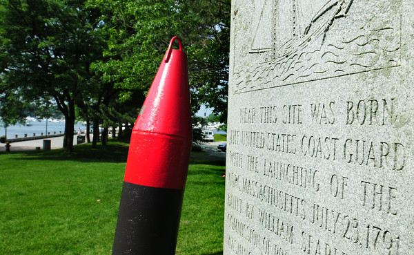 Newburyport: The restored Nun Buoy on Newburyport's Waterfront Park glistens in the sun after US Coast Guard volunteers refurbished the retired naviagation aid presented to the city in 1962. Bryan Eaton/Staff Photo