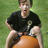 Amesbury: Jack Buckley, 9, hits the ground hard in a game of hippity hop on Monday morning. He was at Amesbury Elementary School's Field Day. Bryan Eaton/Staff Photo