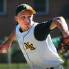 North Reading: North Reading pitcher Ryan McAuliffe winds up in action against Newburyport. Bryan Eaton/Staff Photo
