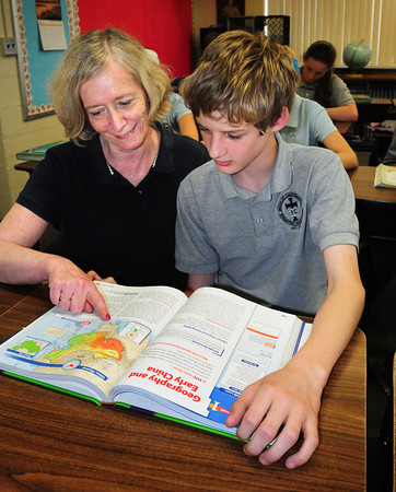 Newburyport: Immaculate Conception School religion teacher Katherine Pearson, shown with student Connor Beevers, 12, is retiring after 30 years at the school. Bryan Eaton/Staff Photo