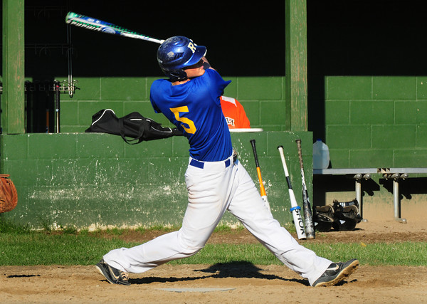 Rowley: Rowley Rams' Cam D'Agostino follows through with a powerful swing that almost went out of Eiras Park but was caught by the Beverly rightfielder. Bryan Eaton/Staff Photo