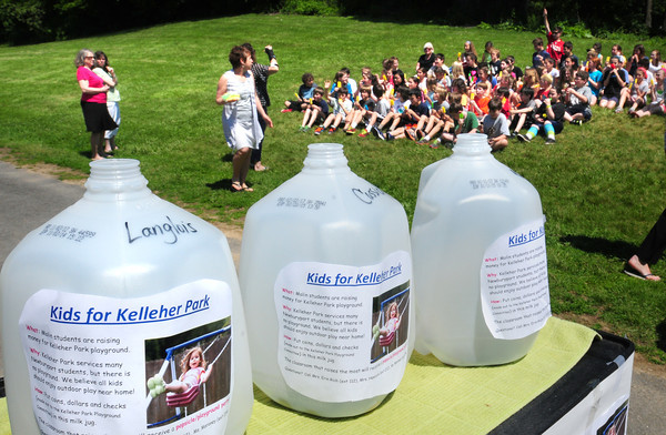 Newburyport: Students at the Upper Molin Elementary School in Newburyport were treated to popsicles as they met to donate the $1,506.00, they collected in these water jugs, to representatives of the group trying to get a new playground built at Kelleher Park. Bryan Eaton/Staff Photo