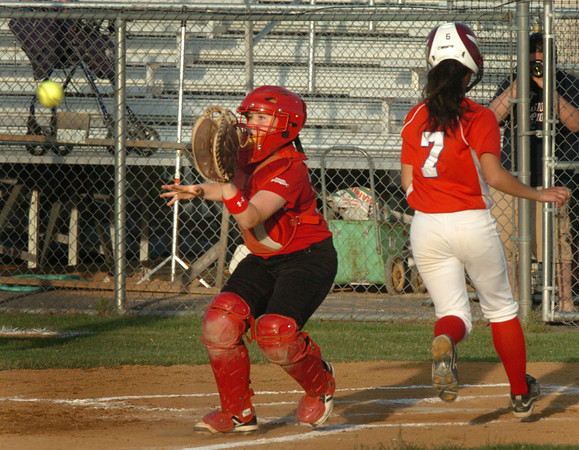 Lowell: The throw comes late to Amesbury catcher Cassandra Schultz as Burlington's Adriana Berardi gets a run. Bryan Eaton/Staff Photo
