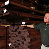 Newburyport: Keiver-Willard Lumber owner Bob Keiver with piles of mahogany. Bryan Eaton/Staff Photo