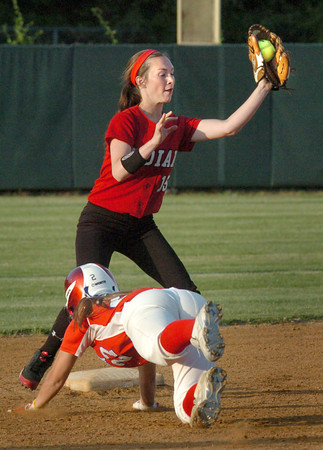 Lowell: Amesbury's Lauren Fedorchak has the catch forcing Burlington's Kelly McCarthy out at second. Bryan Eaton/Staff Photo