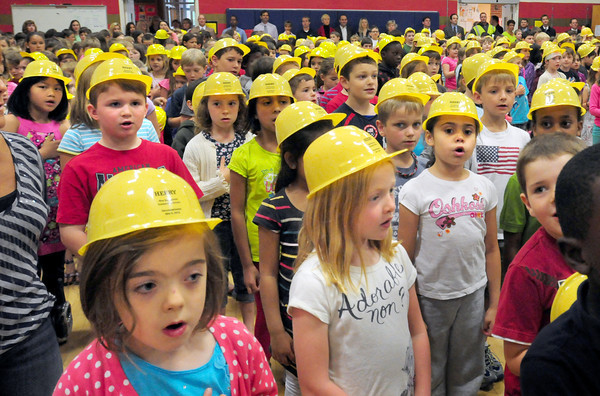 Newburyport: Wearing thier hardhats youngsters sing the National Anthem at the beginning of a ceremonial groundbreaking of the new Bresnahan School yesterday morning. Bryan Eaton/Staff Photo
