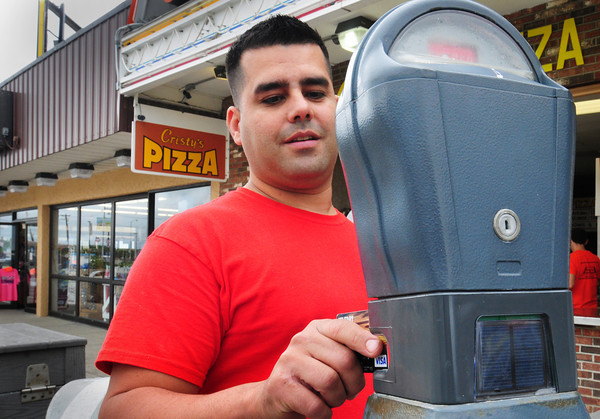 Salisbury: Perci Almeida doesn't have to worry about the change in his pocket if we wants to park in some areas. Several new machines accept credit cards in addition to the traditional quarters which buy ten minutes. Bryan Eaton/Staff Photo
