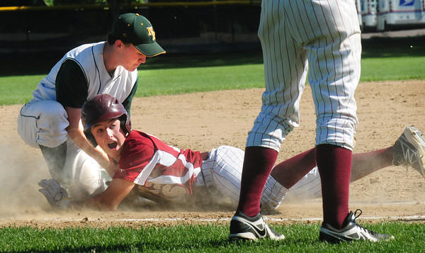 North Reading: Newburyport's Scott Webster makes it safely back to third past baseman Thomas Day after taking a long lead to home plate and almost getting picked off. Bryan Eaton/Staff Photo