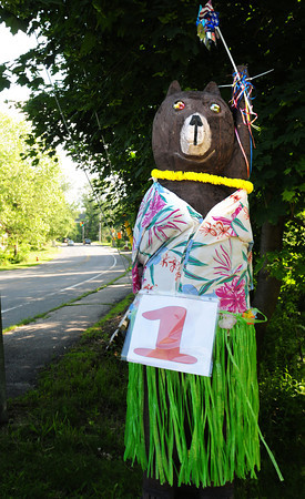 West Newbury: This carved wooden bear on Main Street in West Newbury is often dressed with various themes, this one seeming tropical as today is the first day of summer. Bryan Eaton/Staff Photo