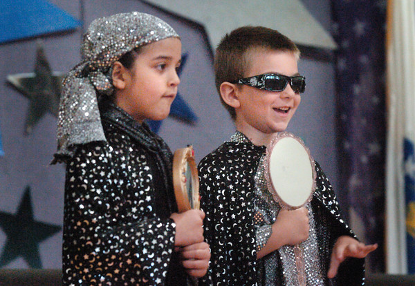 Amesbury: Amesbury's Cashman School first-graders Cala Al-Madhloom, left and Derek Chase portray mirrors in the play Sleeping Beauty. The show was performed for the school Thursday morning and then for parents later at night. Bryan Eaton/Staff Photo