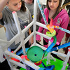 "Seabrook: Brooke Walsh, drops a marble into her team's roller coaster named ""Rocket Science"" with mates Cameron Whelan, center, Rose Slayton and, out of view, Katelyn Deo, all 13. The Seabrook Middle School students were building the roller coasters in their physics section of science learning about accelerations, centrifugal force and the like. Bryan Eaton/Staff Photo"