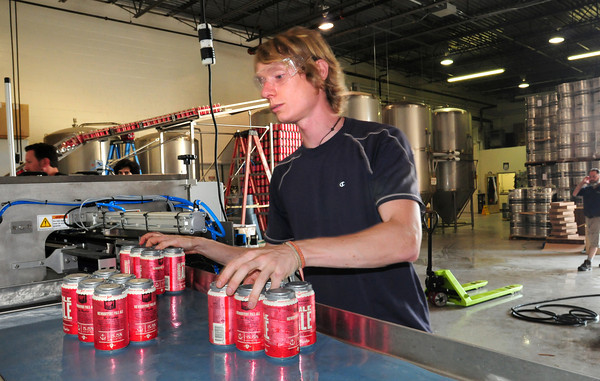 Newburyport: Chadd Cook takes beer off the production line at Newburyport Brewing Co, Bryan Eaton/Staff Photo