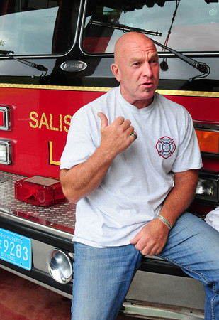 Salisbury: Salisbury firefighter Dana Chouinard describes his role in a rescue of a woman at Salisbury Beach who was apparently trying to drown herself. Bryan Eaton/Staff Photo