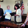 Newburyport: Newburyport Mayor Donna Holaday presents Charlotte McLaughlin with a proclamation honoring her 60th year as a poll worker and warden in the city. Also reading proclamations from the statehouse were state Rep. Mike Costello, left, and state Sen. Kathleen O'Connor Ives, right. Bryan Eaton/Staff Photo