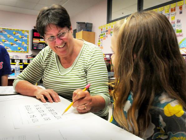 Amesbury: Cashman School teacher Kathy Scholtz, with Julianna Joyce, 7, is one of several teachers retiring in Amesbury. Bryan Eaton/Staff Photo