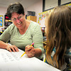 Amesbury: Cashman School teacher Kathy Scholtz, with Julianna Joyce, 7, is one of several teachers retiring in Amesbury. Bryan Eaton/Staff Photo