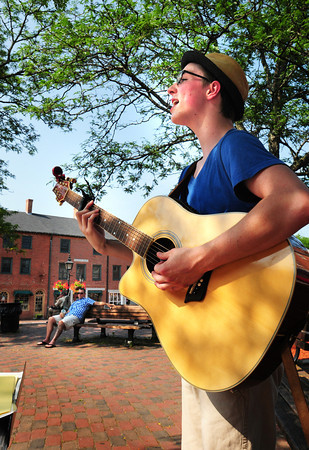 Newburyport: Austin Pratt performs in Newburyport's Market Square on Monday afternoon, a member of Mocking Bird Band. The Epping resident headed to Newburyport after school, as he often does on Mondays, as he says he loves street performing. Bryan Eaton/Staff Photo