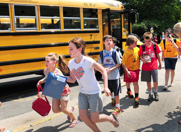 Newburyport: Students at the Bresnahan School head for their buses as Newburyport Schools had their last day of classes as children begin their summer vacation. Bryan Eaton/Staff Photo