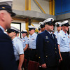 Newburyport: Jason B. Holm, left, walks past US Coast Guard personnel, including his replacement, new officer in charge Mark W. Dilenge, of Station Merrimack RIver, center, in blue, at the end of a change of command ceremony. Bryan Eaton/Staff Photo