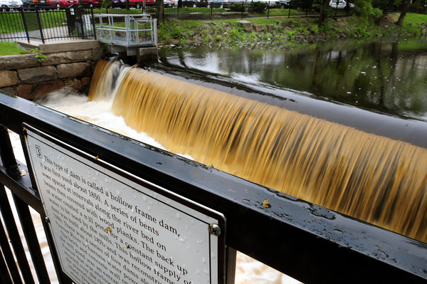 Amesbury: The water is running high over the dam in Amesbury's Upper Millyard, a hollow frame to be exact according to this historical marker. The heavy flow will continue as there's more rain in the forecast. Bryan Eaton/Staff Photo