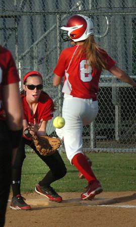 Lowell: Burlington's Kayla Sheldon makes it to first before Amesbury second baseman Lauren Fedorchak has the catch. Bryan Eaton/Staff Photo