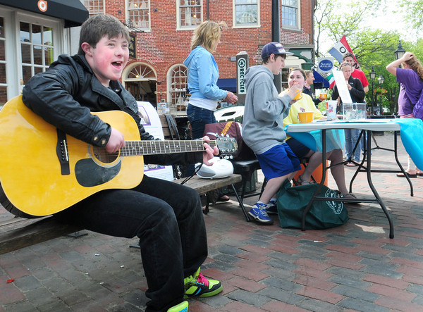 Newburyport: Jared Bedard plays guitar at a fundraiser in Market Square in Newburyport on Monday hoping to meet Justin Bieber by his efforts. Bryan Eaton/Staff Photo