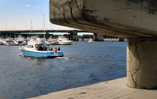 Newburyport: The Erica Lee II returns to port along Newburyport's boardwalk after a day of fishing under blue skies. Those skies are forecast to become cloudy with rain on Friday and early Saturday. Bryan Eaton/Staff Photo