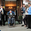BRYAN EATON/ Staff Photo. Jack DiMento is greetied by friends, family and town officials singing The Marine's Hymn at Seaview Retreat Nursing Home. The veteran, who worked for the town for decades on the finance committee, was recognized and presented with a citation for his service. Senator Bruce Tarr and the Rowley selectmen attended.