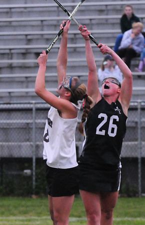 BRYAN EATON/ Staff Photo. Newburyport's  Julia Kipp, left, and Manchester/Essex player Brittany Smith jump for the ball.