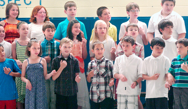"BRYAN EATON/ Staff Photo. Students in Pam Berry's fourth grade class at Amesbury Elementary School sing ""A Different Side of Me"" during the Fourth Grade Celebration on Monday morning. The youngsters will be heading to Amesbury Middle School when classes start in the fall."