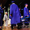 BRYAN EATON/ Staff Photo. Georgetown High's graduating seniors march onto the stage in the auditorium.