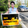 West Newbury: Jane Wild, who is vice president of the Essex County  Beekeepers, and her husband have a sign on their West Newbury home to discourage spraying for mosquitoes which harms their bees. Bryan Eaton/Staff Photo