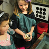 BRYAN EATON/ Staff Photo. Claire Seese, 4, left, and Phoebe Dooling, 5, look at a hermit crab they took from the touch tank at the Merrohawke Nature School. They were participating in the Newburyport Montessori School's Summer Arts Program which focuses on the community.