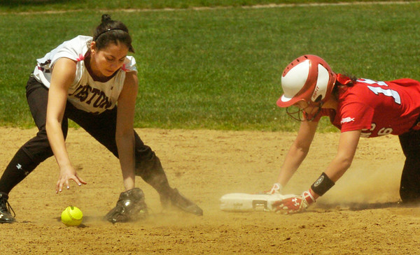 BRYAN EATON/ Staff Photo. Amesbury's Amanda Schell makes the steal to second after hitting a single earlier.