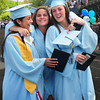 BRYAN EATON/ Staff Photo. Valedictorian Nicole Indingaro, left, Amanda Colpitts and Colleen Barrett, right, celebrate as they walk off the field.