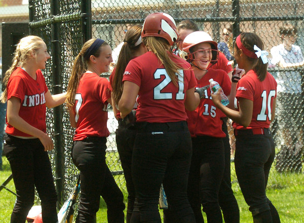 BRYAN EATON/ Staff Photo. Amesbury softball players celebrate one of several homeruns in the second inning.