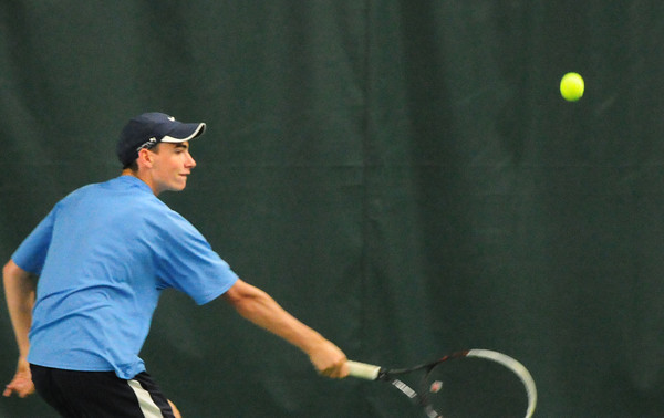 BRYAN EATON/ Staff Photo. Triton's Travis Mihalchik in first singles action with North Reading.