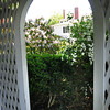 BRYAN EATON/ Staff Photo. View from inside the summer house at the Moulton Garden at 91 High Street.