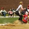 BRYAN EATON/ Staff Photo. Amesbury's Autumn Kilgerman slides into third on a hit.
