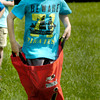BRYAN EATON/ Staff Photo. Daniel Smith, 7, moves along in the sack race at Field Day at Salisbury Elementary School on Tuesday morning.