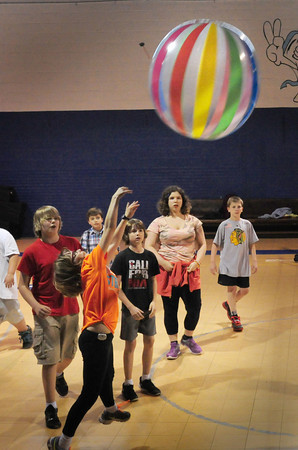 BRYAN EATON/Staff Photo. There were no activities outside at the Boys and Girls Club in Salisbury on Thursday due to the rain, but there were plenty of things to do inside including playing Giant Volleyball.