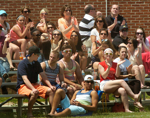 BRYAN EATON/ Staff Photo. Amesbury fans cheer a home run during play against Weston yesterday.