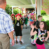 BRYAN EATON/ Staff Photo. Amesbury Elementary School principal Walter Helliesen waves by to his students as Amesbury Schools let out yesterday morning for summer vacation.