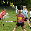 BRYAN EATON/ Staff Photo. Newburyport High girls lacrosse team practices yesterday.