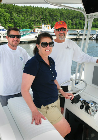 "BRYAN EATON/ Staff Photo. Striper tournament principals from left, Hatter's Point Marina dock manager Andy Knapp, with office manager Paula McPartland and Greg Chorebanian of the M/V Bounty Hunter out of Gloucester which is featured on the television show ""Wicked Tuna."""