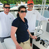 """BRYAN EATON/ Staff Photo. Striper tournament principals from left, Hatter's Point Marina dock manager Andy Knapp, with office manager Paula McPartland and Greg Chorebanian of the M/V Bounty Hunter out of Gloucester which is featured on the television show """"Wicked Tuna."""""""
